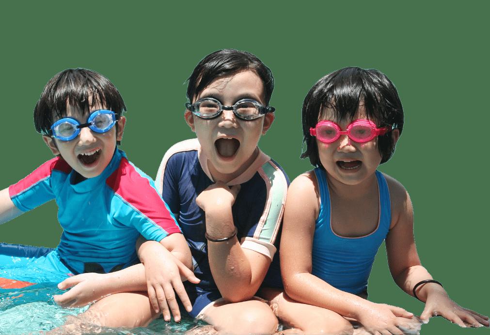 Three kids enjoy swimming